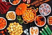 Halloween Candy Buffet Table Scene Over A Black Stone Background. Assortment Of Sweet, Spooky Treats poster