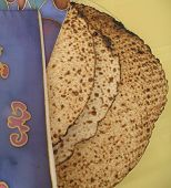 pic of matzah  - Jewish Holidays: Traditional Matzah Laid Out on Passover Seder Table