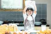 Healthy Family.  Smiling Asian Boy Cooking Toast And Make Bread In Holiday.  Kid Making And Leaning  poster