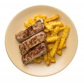 Grilled Pork Ribs With French Fries On A Light Brown Plate. Pork Ribs With French Fries On A White B poster