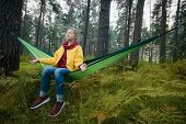 Woman Resting In Hammock Outdoors. Meditation Outdoors. Relax Time On Holiday Concept Travel. poster