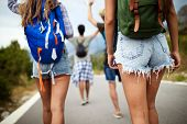 Group Of Happy Friend Traveler Walking And Having Fun. Travel Lifestyle And Vacation Concept poster