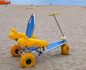 Beach Wheel Chair For Disabled Swimmers In The Sandy Beach On Sea Background. poster