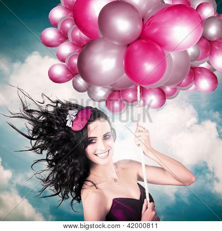 Celebration. Happy Fashion Woman Holding Balloons