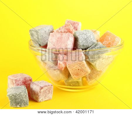rahat lokum in bowl on yellow background