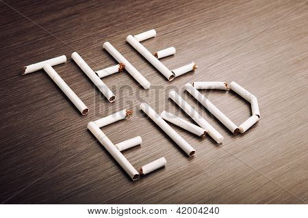 """Concept Of Dangers Of Smoking. Word """"the End"""" Of Cigarettes"""