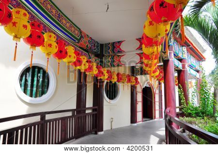Red And Yellow Lanterns Along Passageway