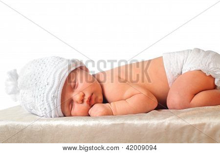 Sleeping Newborn Baby Girl In White Hat Wearing Diaper