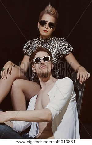 Young Men And Women Wearing A Stylish Sunglasses