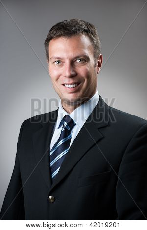 Business Man In Dark Suit