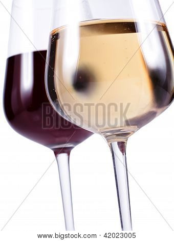Close Up Of Two Wine Glasses With Red And White Wine