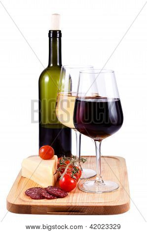 Two Wine Glasses With Red And White Wine, Bottle Of Wine, Tomato, Cheese And Sausage