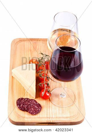 Two Wine Glasses With Red And White Wine, Tomato, Cheese And Sausage