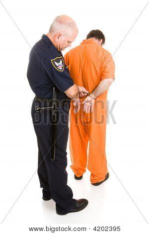 Policeman Handcuffs Prisoner