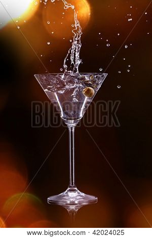 martini drink over dark background