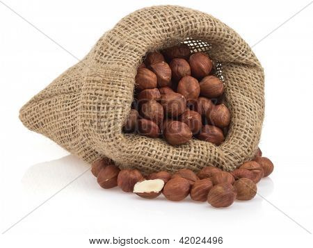nuts hazelnut in sack bag  isolated on white background