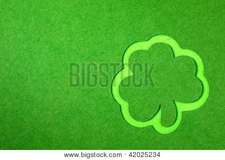 St. Patrick clover cut from paper. Greeting card. Paper craft.