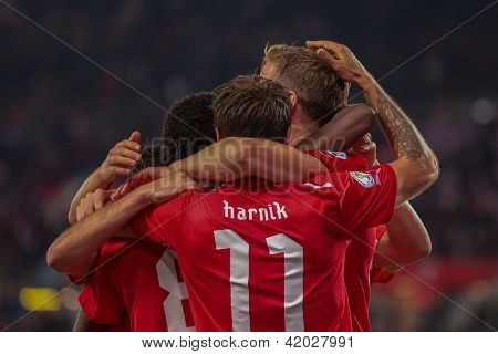 VIENNA,  AUSTRIA - OCTOBER 16: Marc Janko (#21 Austria) and Martin Harnik (#11 Austria) celebrate after a goal during the WC qualifier soccer game on October 16, 2012 in Vienna, Austria.