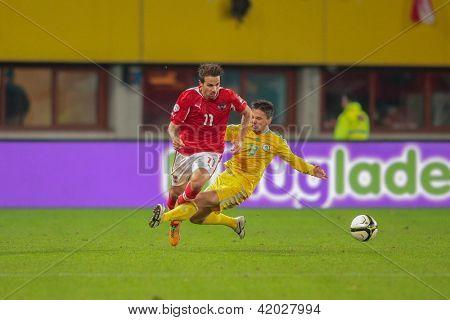 VIENNA,  AUSTRIA - OCTOBER 16:  Azat Nurgaliyev (#13 Kazakhstan) fouls Martin Harnik (#11 Austria) fight for the ball during the WC qualifier soccer game on October 16, 2012 in Vienna, Austria.