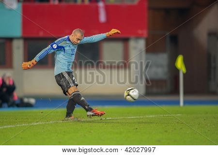 VIENNA,  AUSTRIA - OCTOBER 16: Andrei Sidelnikov (#22 Kazakhstan) kicks the ball during the WC qualifier soccer game on October 16, 2012 in Vienna, Austria.