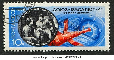 USSR - CIRCA 1975: A stamp printed in USSR shows image of the Salyut 4 space station and Soviet cosmonauts Pyotr Ilyich Klimuk (1942) and Vitaly Ivanovich Sevastyanov (1935-2010), circa 1975.