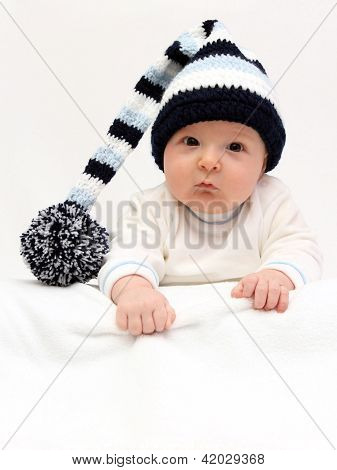 Baby With Knitted Hat Looking