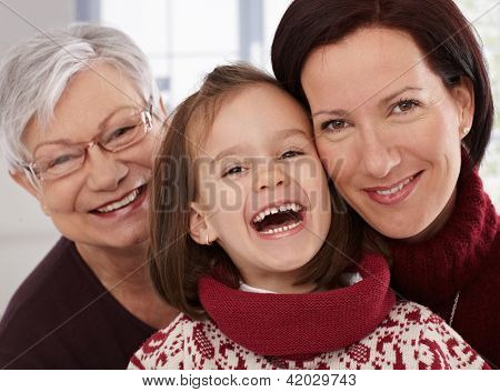 Closeup portrait of generations, grandmother, mother and little girl smiling happily.
