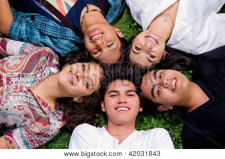 Happy smiling group of young friends