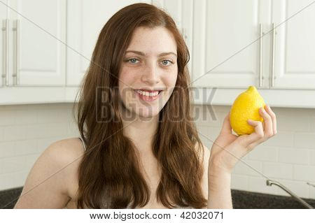 Young Woman Holds Lemon