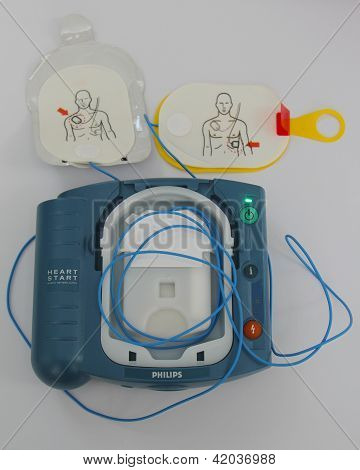 Automated External Defibrillator activated with pads