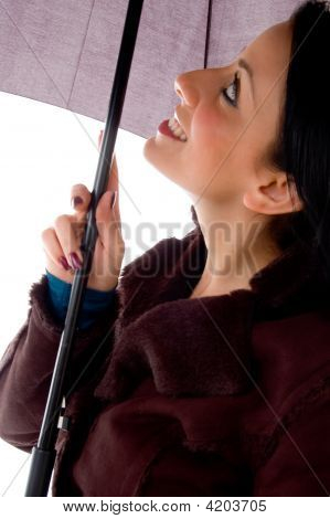Side View Of Smiling Woman Looking Umbrella On White Background