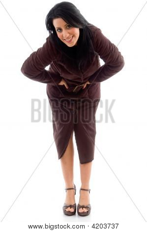 Front View Of Bending Woman Wearing Overcoat On White Background