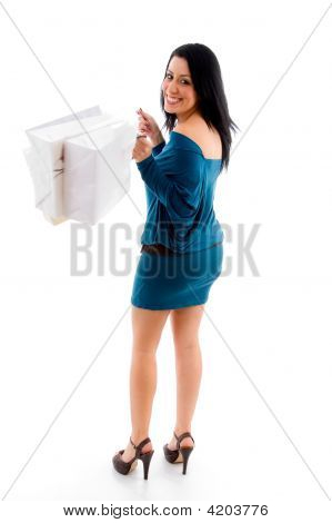 Side View Of Female With Shopping Bags On White Background