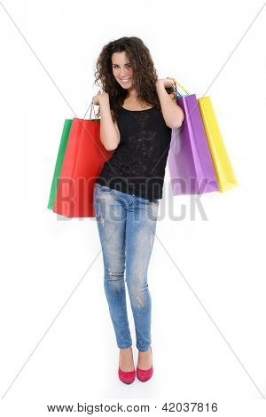 full length portrait of beautiful happy young woman with colored shopping sale bags over white