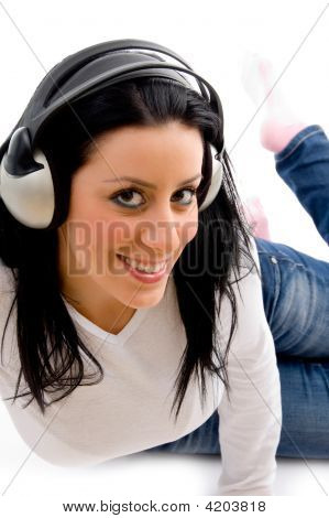 Front View Of Smiling Female Listening Music On White Background