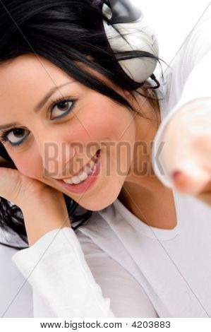 Top View Of Pointing Female Enjoying Music On An Isolated White Background