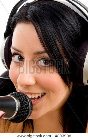 Close Up Of Woman With Headphone And Microphone On An Isolated White Background
