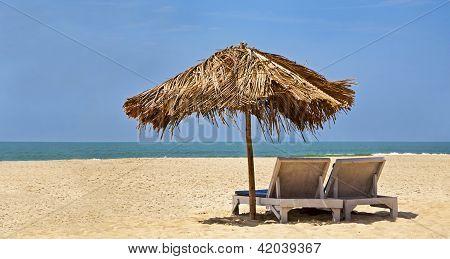 Loungers Desserted Beach Blue Sky