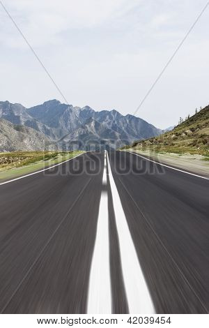 Straight Line Highway Among Mountains