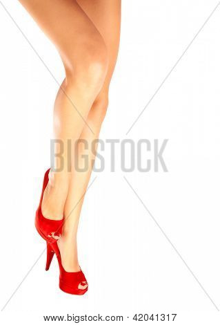 Picture of beautiful female legs in red shoes on high heels isolated on white background, slim girls feet wearing stylish footwear, fashionable accessories, woman body part, shopping and sale concept