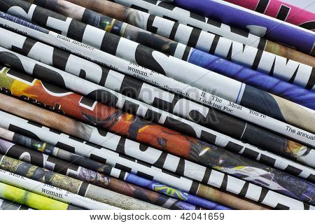 Stacked Newspapers Or Journals