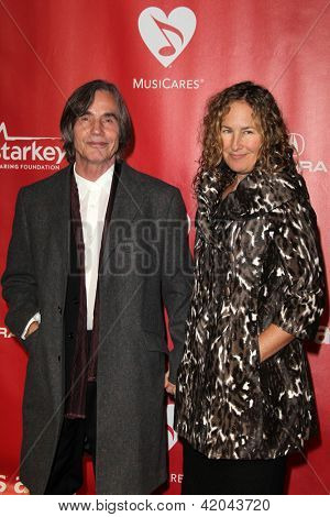 LOS ANGELES - FEB 8:  Jackson Browne, Dianna Cohen arrives at the 2013 MusiCares Person Of The Year Gala  at the Los Angeles Convention Center on February 8, 2013 in Los Angeles, CA