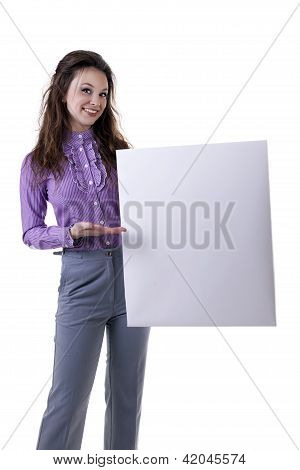 Gorgeous Businesswoman Pointing At A Bord Isolated On White