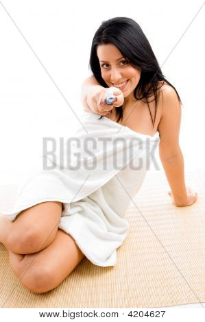 Front View Of Woman Showing Toothbrush Against White Background