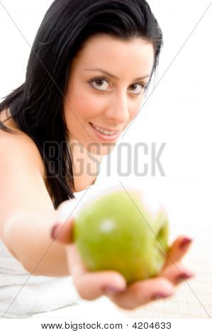 Front View Of Female Offering Apple On An Isolated White Background