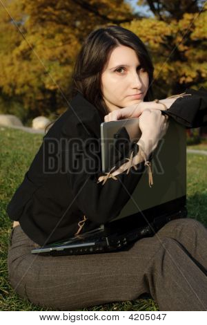 The Girl Embraces A Portable Computer
