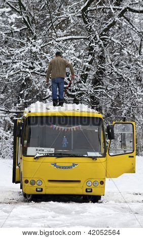 Kiev, Ukraine - February 10: The Man Cleans Snow From A Bus Roof After Snowfall,february 10, 2013In