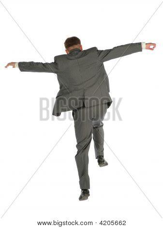 Behind Jumping Businessman