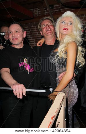 LOS ANGELES - FEB 9:  Doug Hutchison, Alex Stodden, Courtney Stodden at the World Premiere of Courtney Stodden's