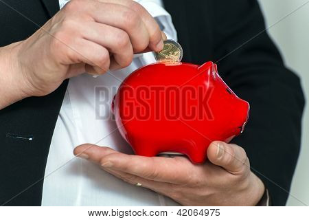 Close Up Pregnant Business Womans Hands With Piggy Bank